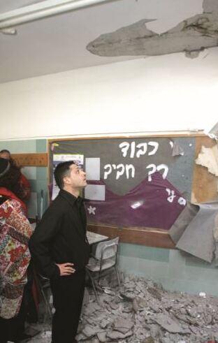 רוביק דנילוביץ' בבית הספר מקיף ו' שנפגע מטיל גראד בדצמבר  2008